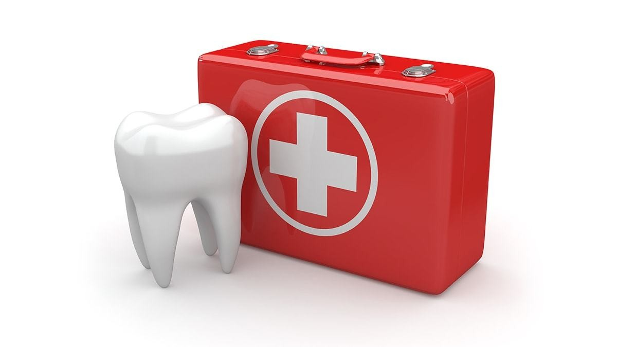 First Aid Kit Next to Large Tooth Model